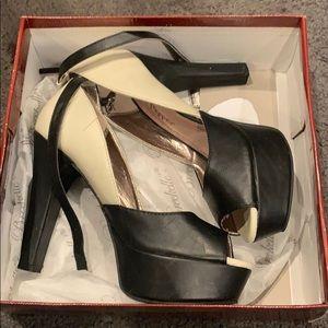 Black and cream heels with peep toe